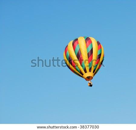 Hot Air Balloon against a blue sky - stock photo