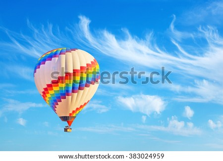 Hot-air balloon and blue sky. - stock photo