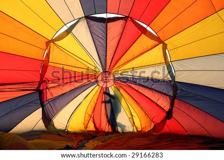 Hot air balloon and man sillhoutte - stock photo