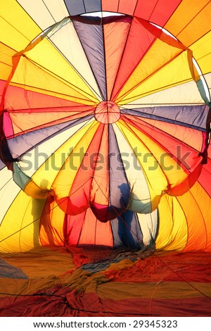 Hot air balloon and silhouette of people - stock photo