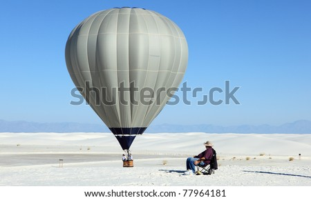 Hot air balloon and white sand dune  at White Sands National Monument, New Mexico, USA - stock photo