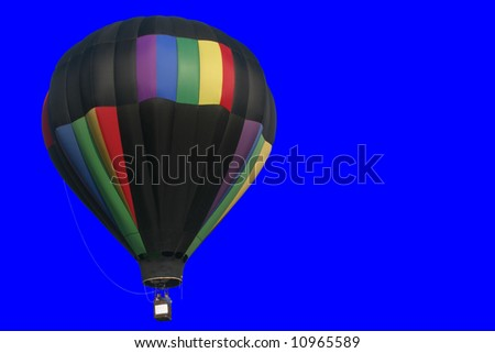 Hot air balloon - Black - Isolated on blue background.