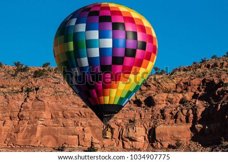 Hot air balloon festival in Kanab, UT., called Balloons and Tunes is extremely colorful because of the contrast between the red rock desert, the balloons and the deep blue sky.