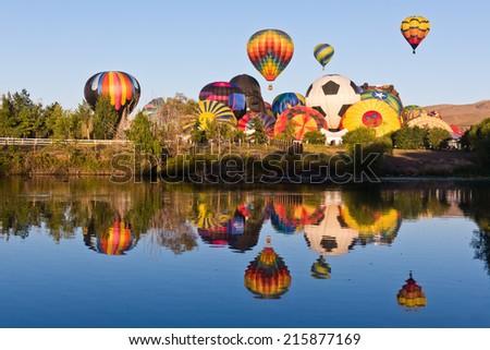 Hot Air Balloon Festival Reflection in Lake - stock photo