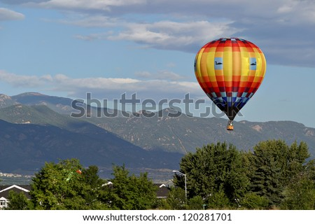 hot air balloon flight mountains - stock photo