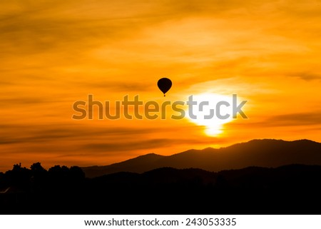Hot air balloon fly up in the air with silhouette environment