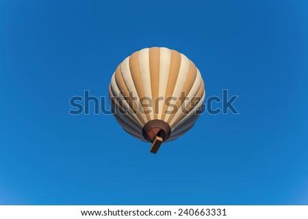hot air balloon flying in cappadocia sky - stock photo