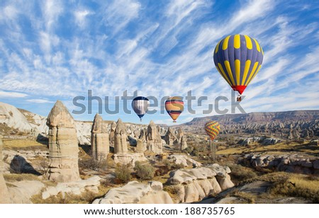 Hot air balloon flying over Cappadocia  - stock photo