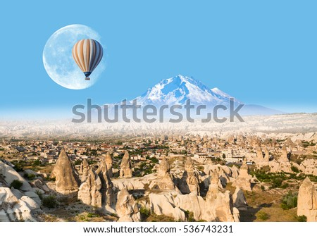 "Hot air balloon flying over spectacular Cappadocia  ""Elements of this image furnished by NASA """
