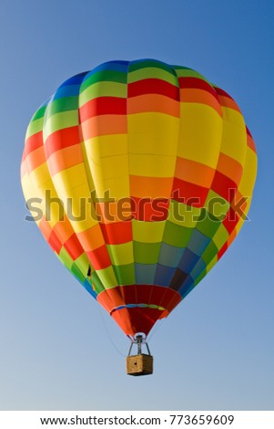 Hot-air balloon in blue sky