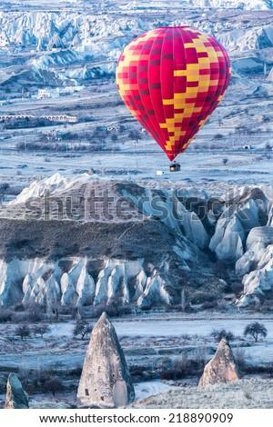 Hot air balloon in Kapadokya/Cappadocia hot air baloon over Cavusin/Hot air baloon over volcanic landscape - stock photo