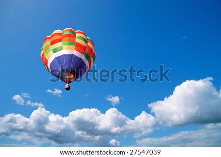 Hot air balloon in the blue sky, wanderlust