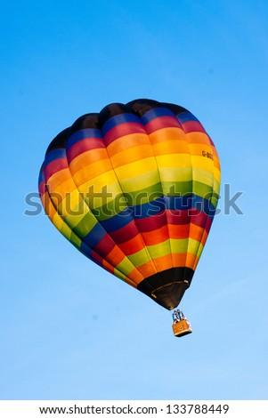 hot air balloon isolated on sky - stock photo