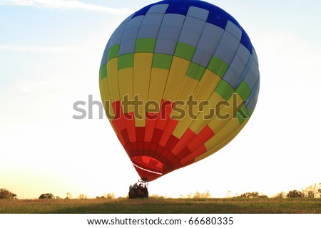 Hot Air balloon landed in the field at dawn