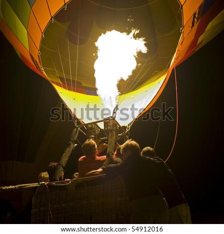 Hot air balloon, lighting phase. - stock photo