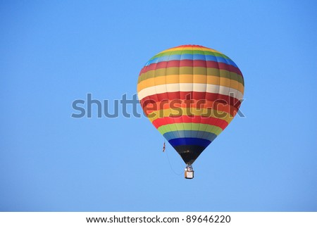 hot air balloon on clear blue sky. - stock photo