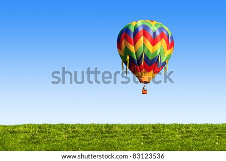 hot air balloon over blue sky - stock photo
