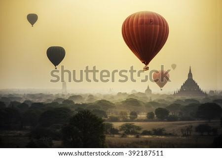 Hot air balloon over plain of Bagan in misty morning, Mandalay, Myanmar   - stock photo