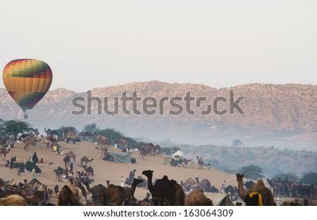 Hot air balloon over Pushkar Camel Fair ground, Pushkar, Ajmer, Rajasthan, India - stock photo