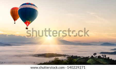 Hot air balloon over sea of mist - stock photo