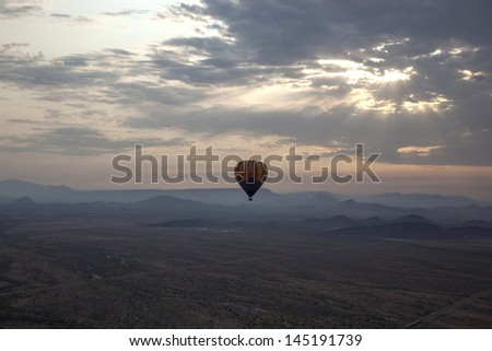 Hot Air Balloon over the Arizona desert - stock photo