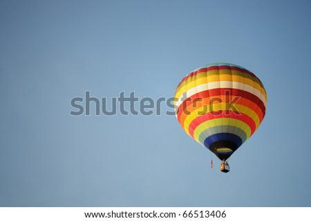 Hot-air balloon over the blue sky