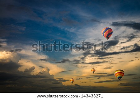 Hot air balloon over the dramatic sky - stock photo