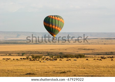 Hot Air Balloon Over the Masai Mara, Kenya - stock photo