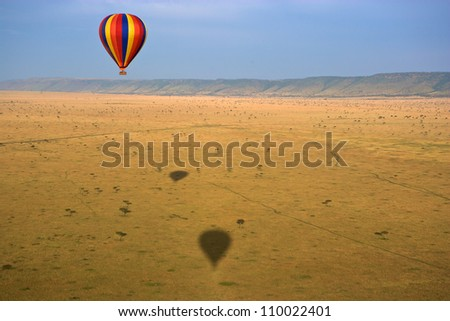Hot air balloon over the Masai Mara National Reserve, Kenya, Africa - stock photo