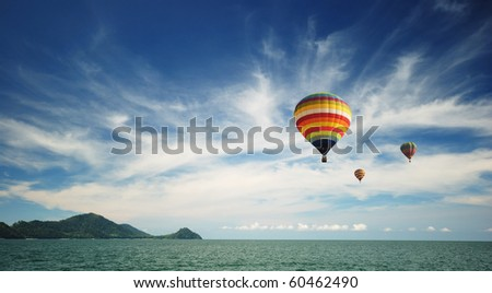 Hot air balloon over the sea - stock photo