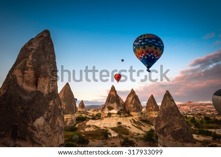 Hot air balloon trip flying over landscape at Cappadocia - stock photo