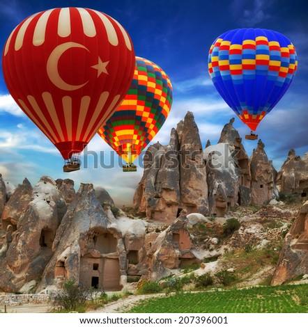 Hot air balloon turkey sign flying mountain valley Cappadocia Turkey - stock photo