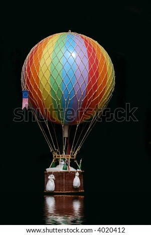 Hot air balloon with basket - stock photo