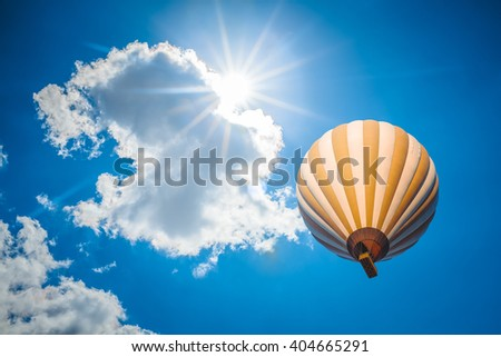 hot air balloon with blue cloudy sky background - stock photo