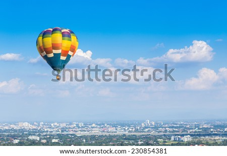 Hot air balloon with blue sky background - stock photo