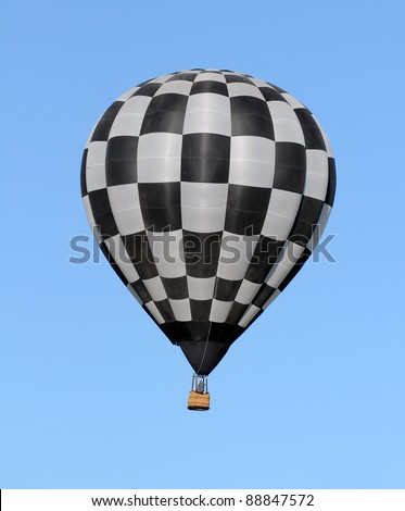 Hot air balloon with checkered colors - stock photo