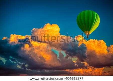 hot air balloon with cloudy sunrise background - stock photo