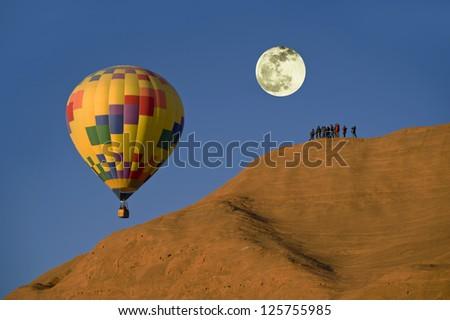 Hot Air Balloon With Full Moon. - stock photo