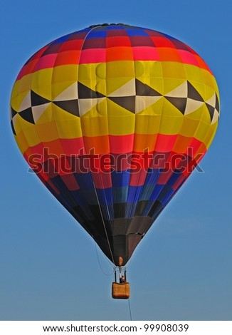 Hot air balloon with geometric shapes in sky