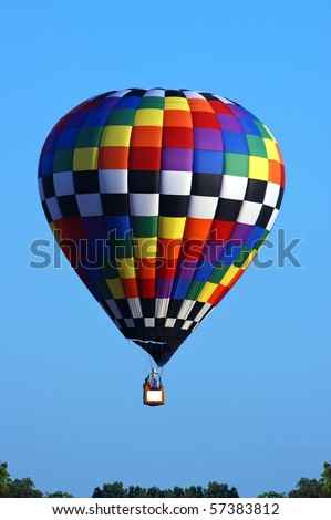 Hot air balloon with spot for logo on basket - stock photo