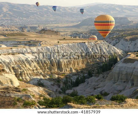 Hot air balloons above a gorgeous landscape - stock photo