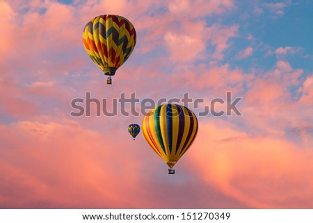 hot air balloons against a beautiful sky