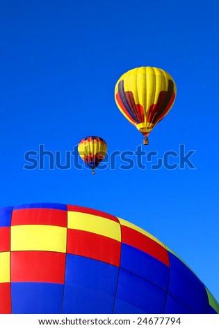 Hot air balloons against brilliant blue sky - stock photo