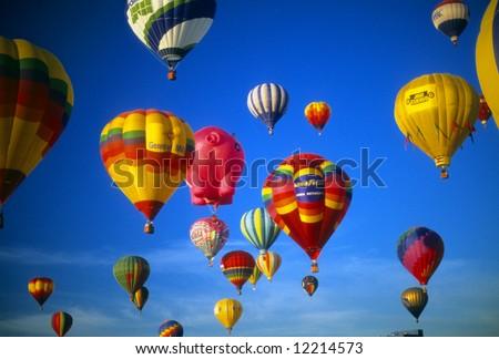 Hot air balloons agaisnt blue sky, International Balloon Festival, Albuquerque, New Mexico - stock photo