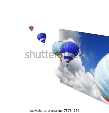 Hot air balloons floating out of an imaginary sheet of dramatic blue cloudy sky with copyspace for text. - stock photo