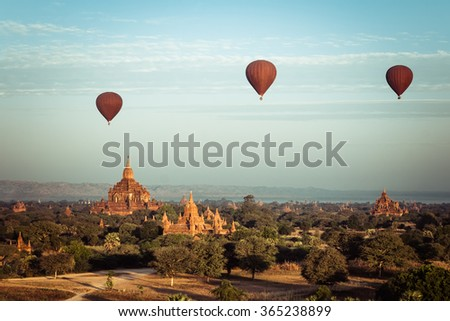 Hot air balloons flying at sunrise over ancient Buddhist Temples at Bagan. Myanmar (Burma) travel landscape and destinations - stock photo