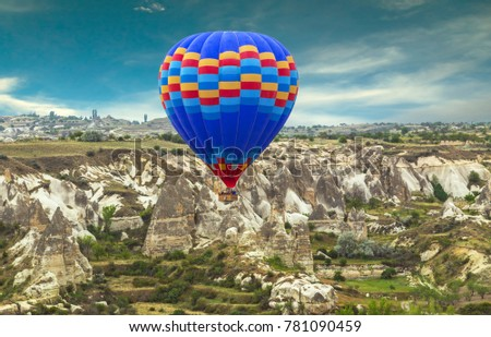 Hot Air balloons flying over Mountains landscape sunset Volcanic rocks, Cappadocia, Anatolia, Turkey.