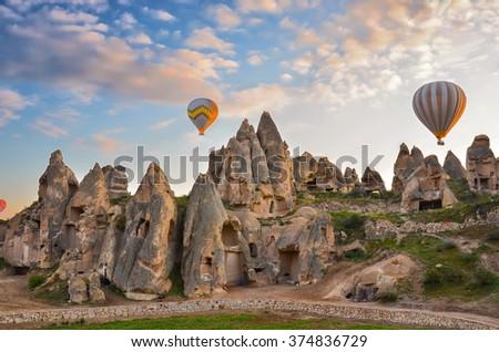 Hot air balloons flying over spectacular Cappadocia. - stock photo