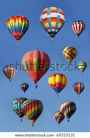 Hot Air Balloons in Mass Ascension, vertical - stock photo