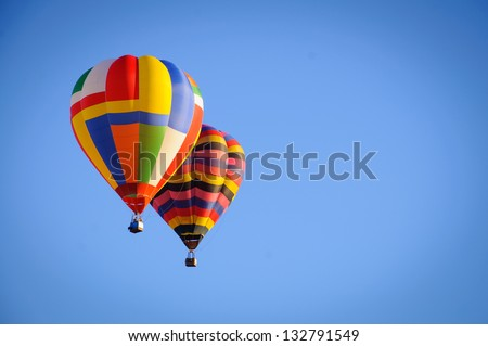 Hot Air Balloons in sky - stock photo